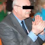 Były komornik sądowy Marek R. zakuty w kajdanki i doprowadzony do zakładu karnego
